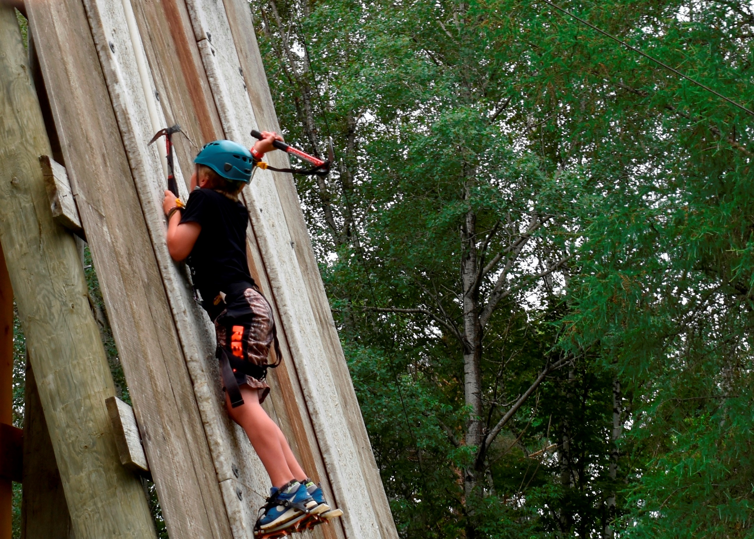 Camper doing Artificial Ice Climbing outside at Christian Adventure Summer Camp