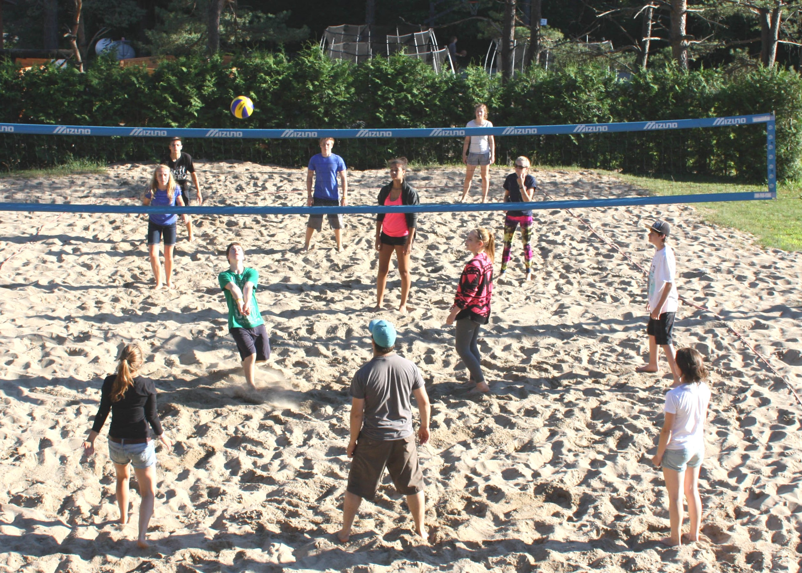 Leadership in Training campers playing beach volleyball outside at christian adventure summer camp in haliburton, ontario