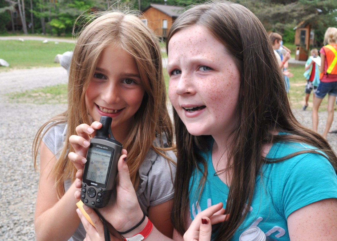 Campers using GPS during Geocaching at Christian Adventure Summer camp in Haliburton, Ontario