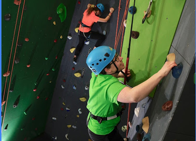 Staff climbing in indoor rock climbing gym at christian adventure summer camp in Haliburton, Ontario