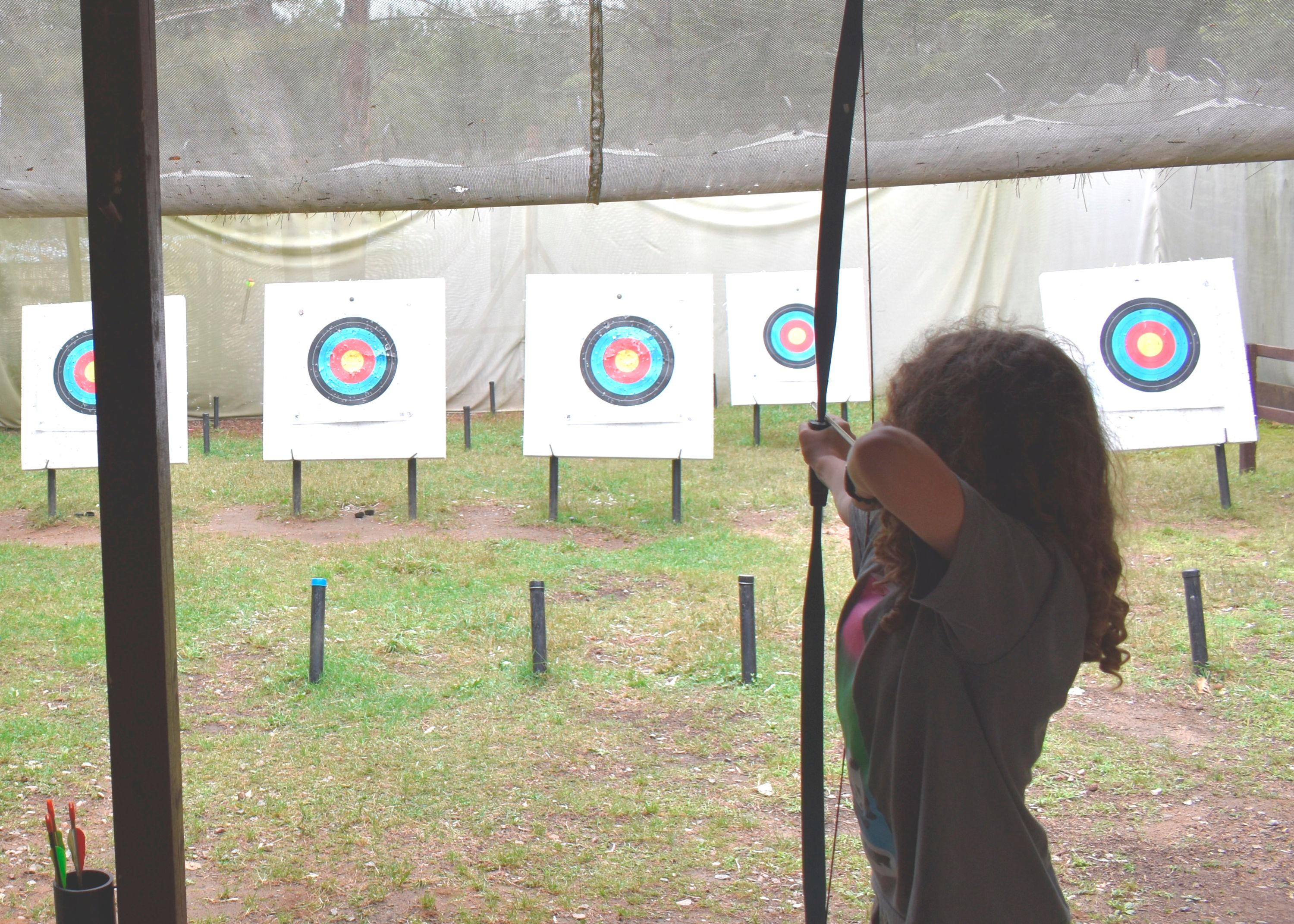 Camper doing Archery outside at Christian Adventure Summer Camp