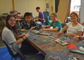 Campers doing arts & crafts inside at christian adventure summer camp