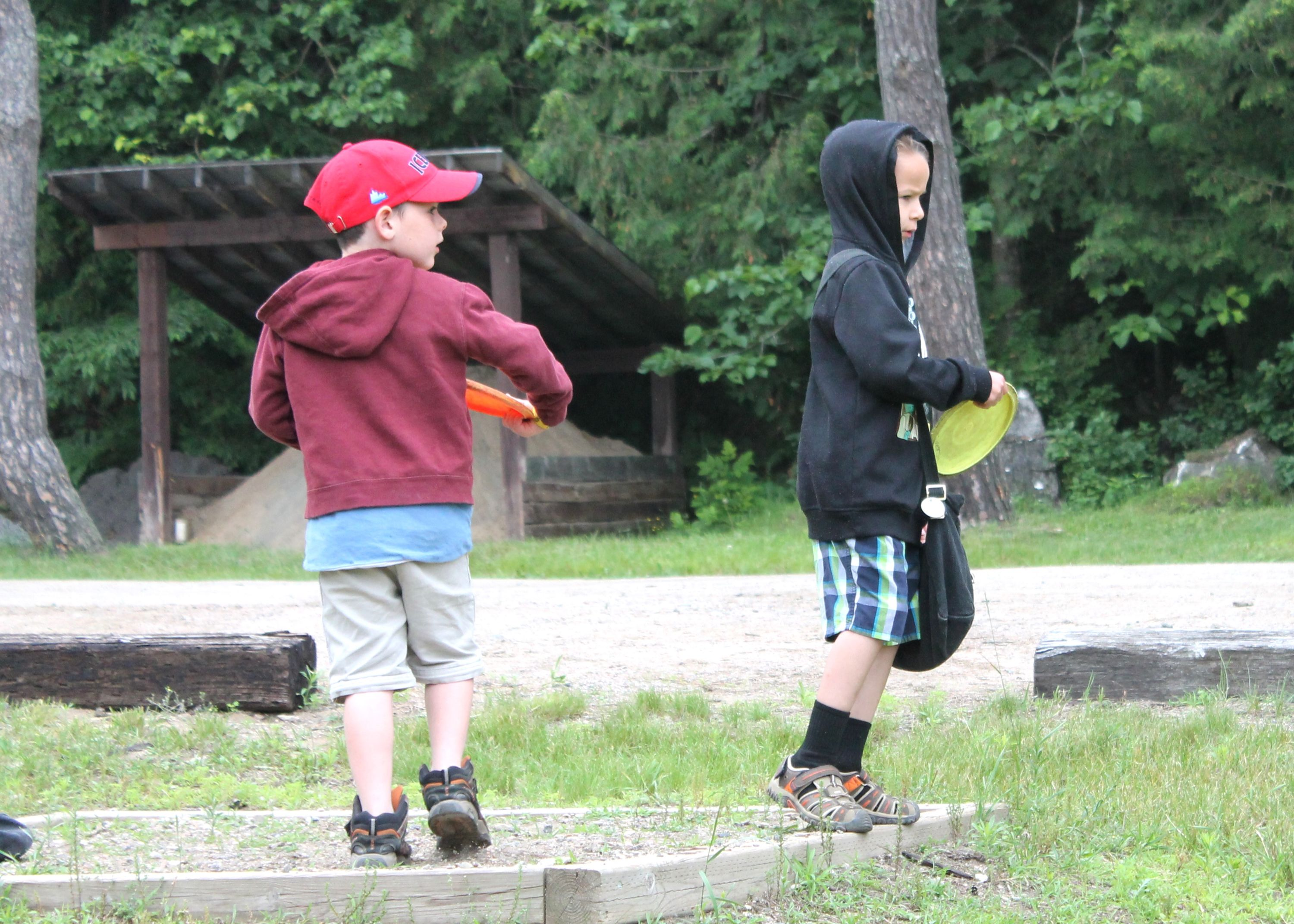 Campers playing disc golf outside at christian adventure summer camp in Northern Ontario