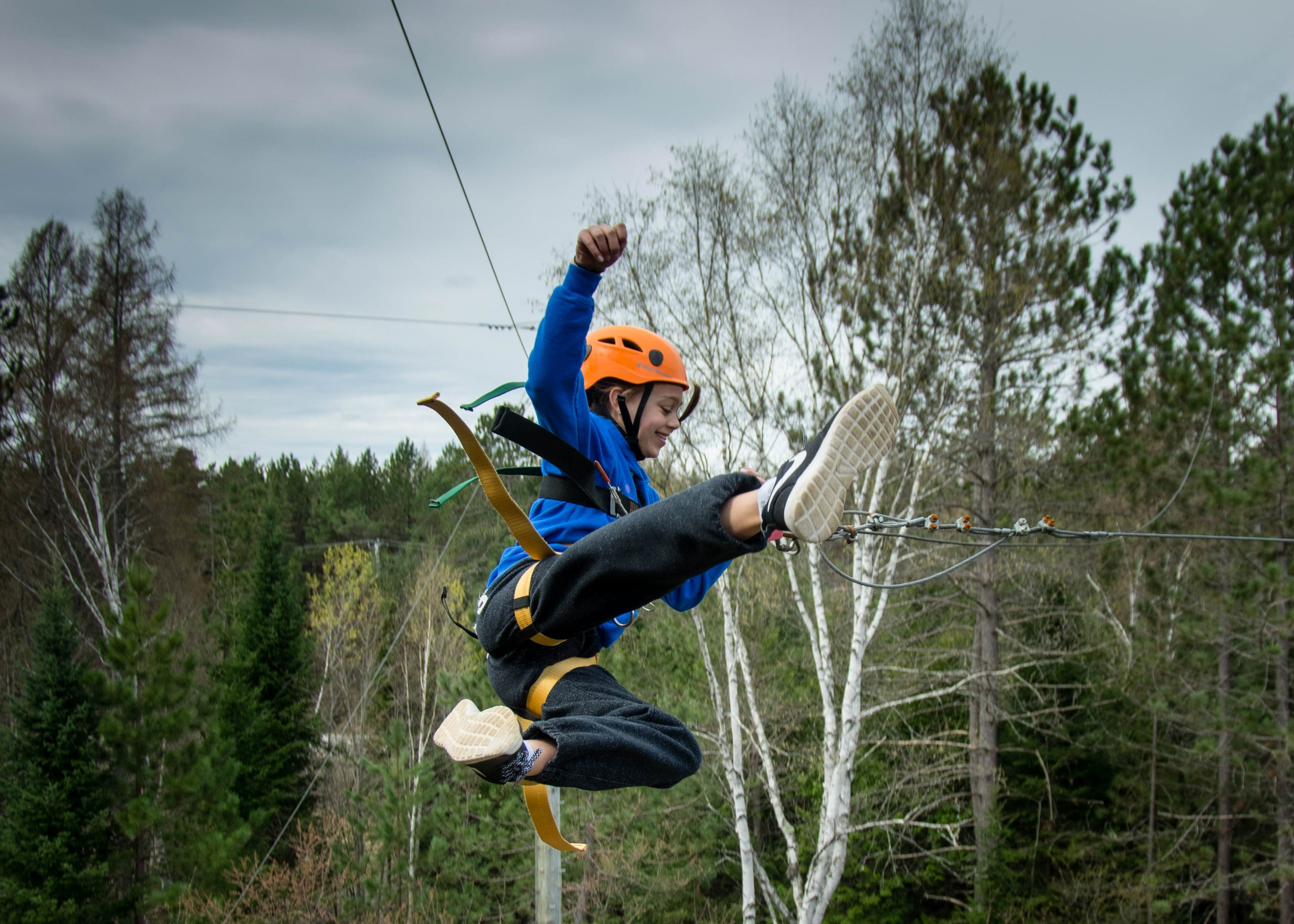 Camper on Giant swing at christian adventure summer camp in northern ontario