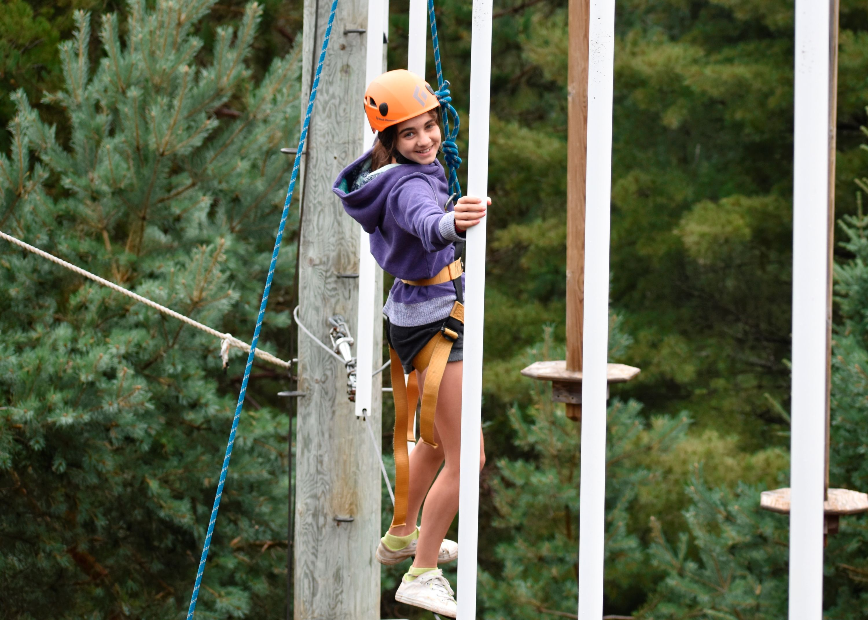 Camper doing high ropes at christian adventure summer camp in haliburton, ontario