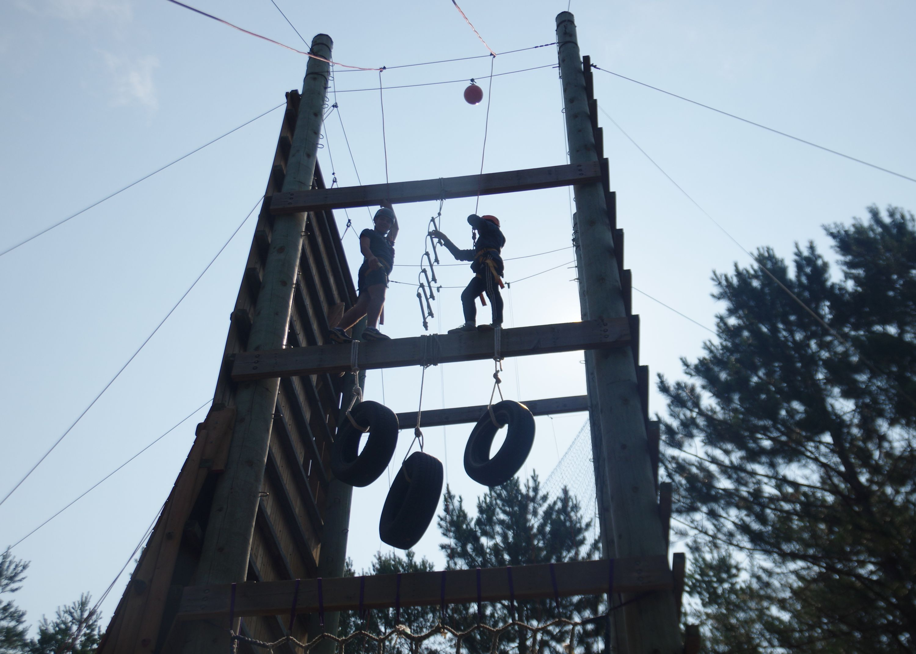 Campers doing Jacob's Ladder Verticle Team Challenge at christian adventure summer camp in Haliburton, Ontario