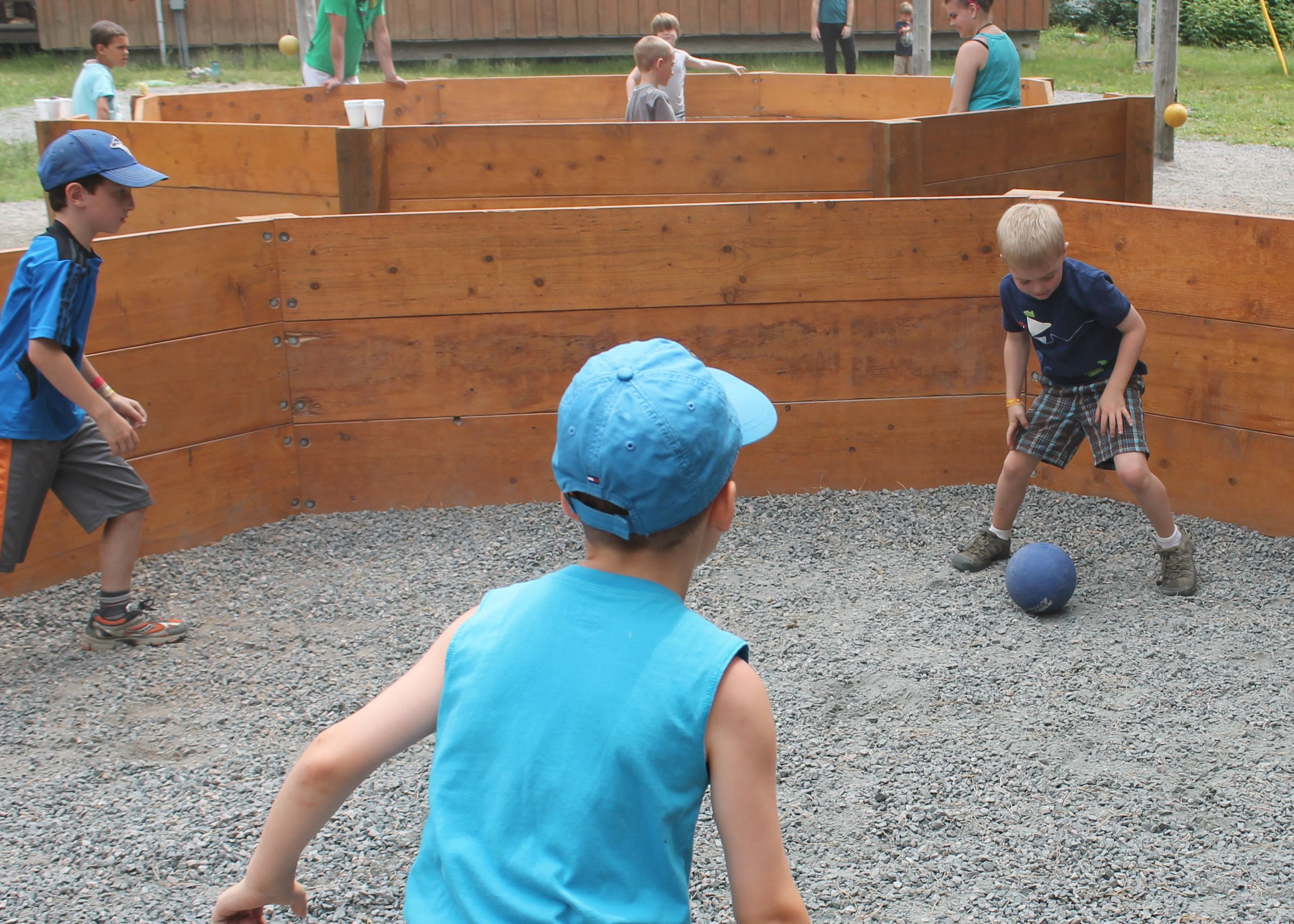 Campers playing octaball outside at christian adventure summer camp in Haliburton, Ontario