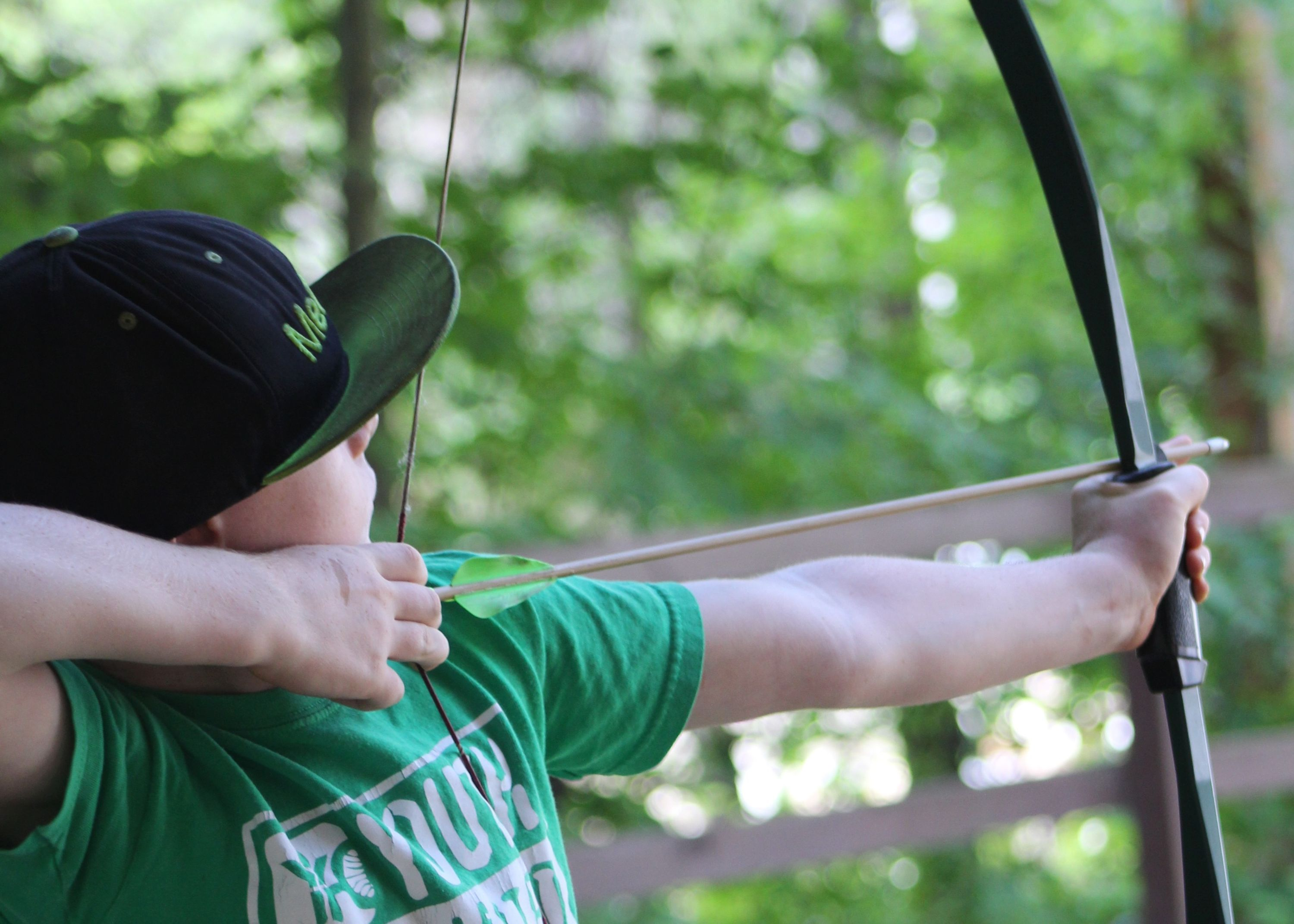 camper doing archery  at Medeba Summer Camp in Haliburton