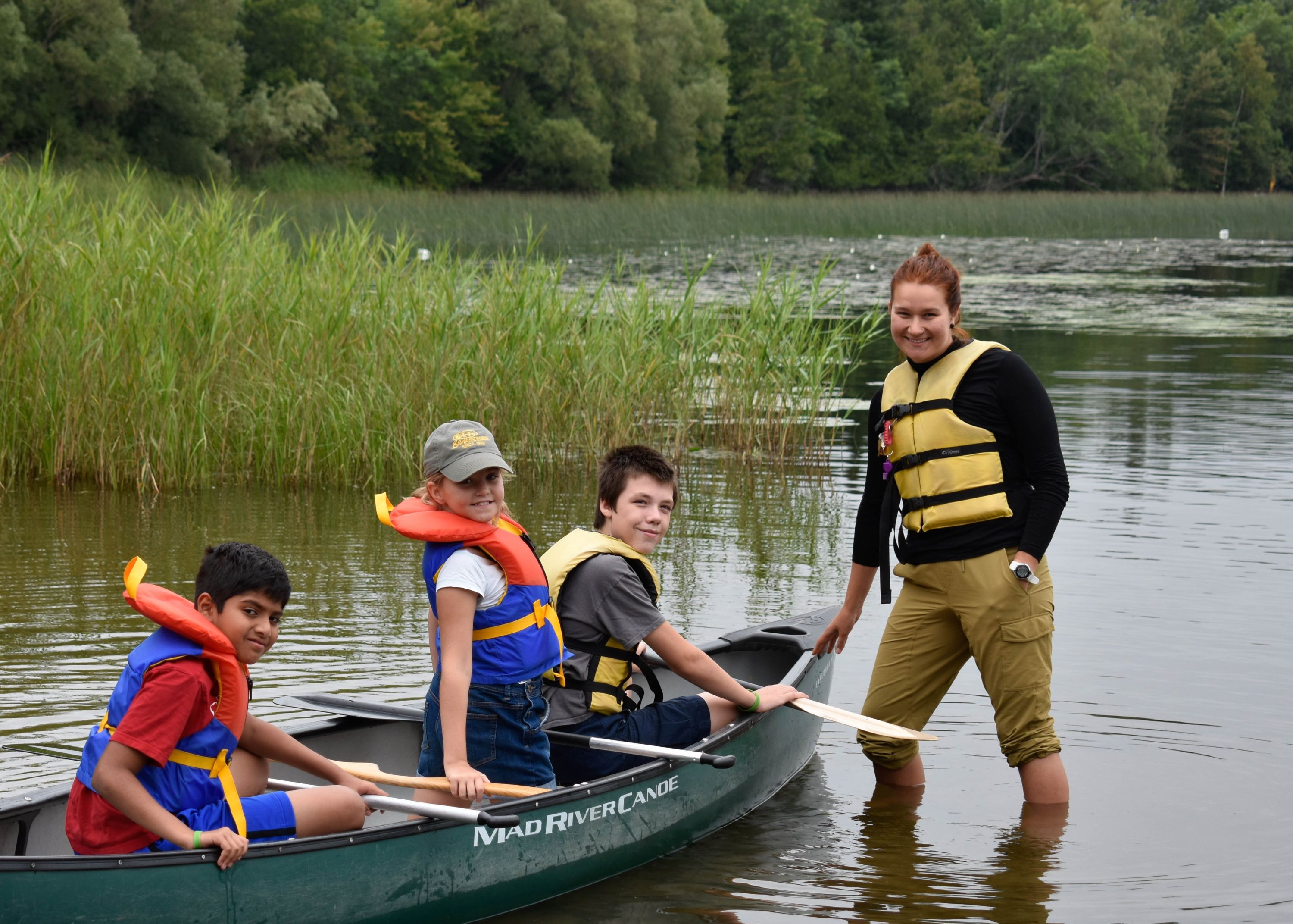 campers canoeing in Grass lake, Medeba, Haliburton
