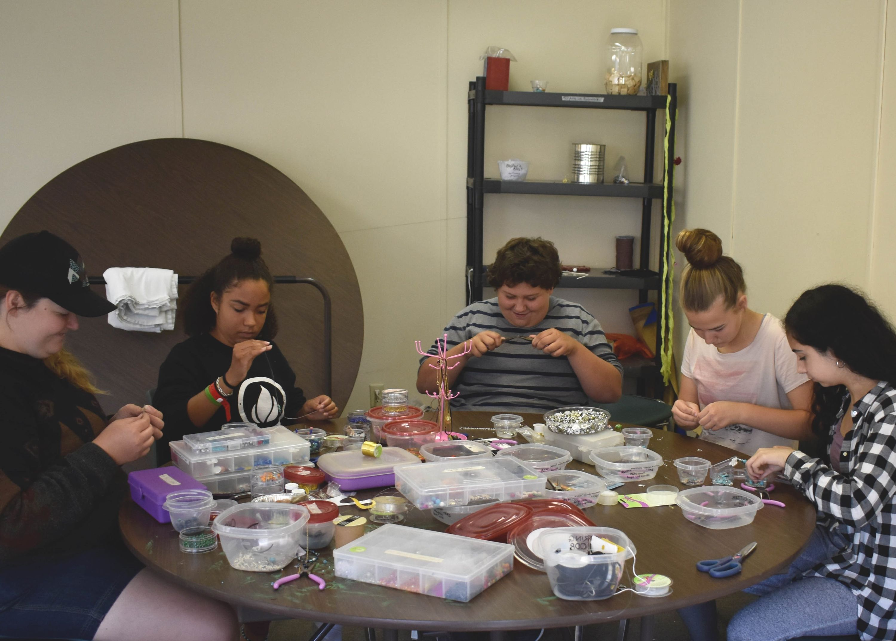 campers working in their jewellery creations at christian Summer Camp in haliburton, ontario