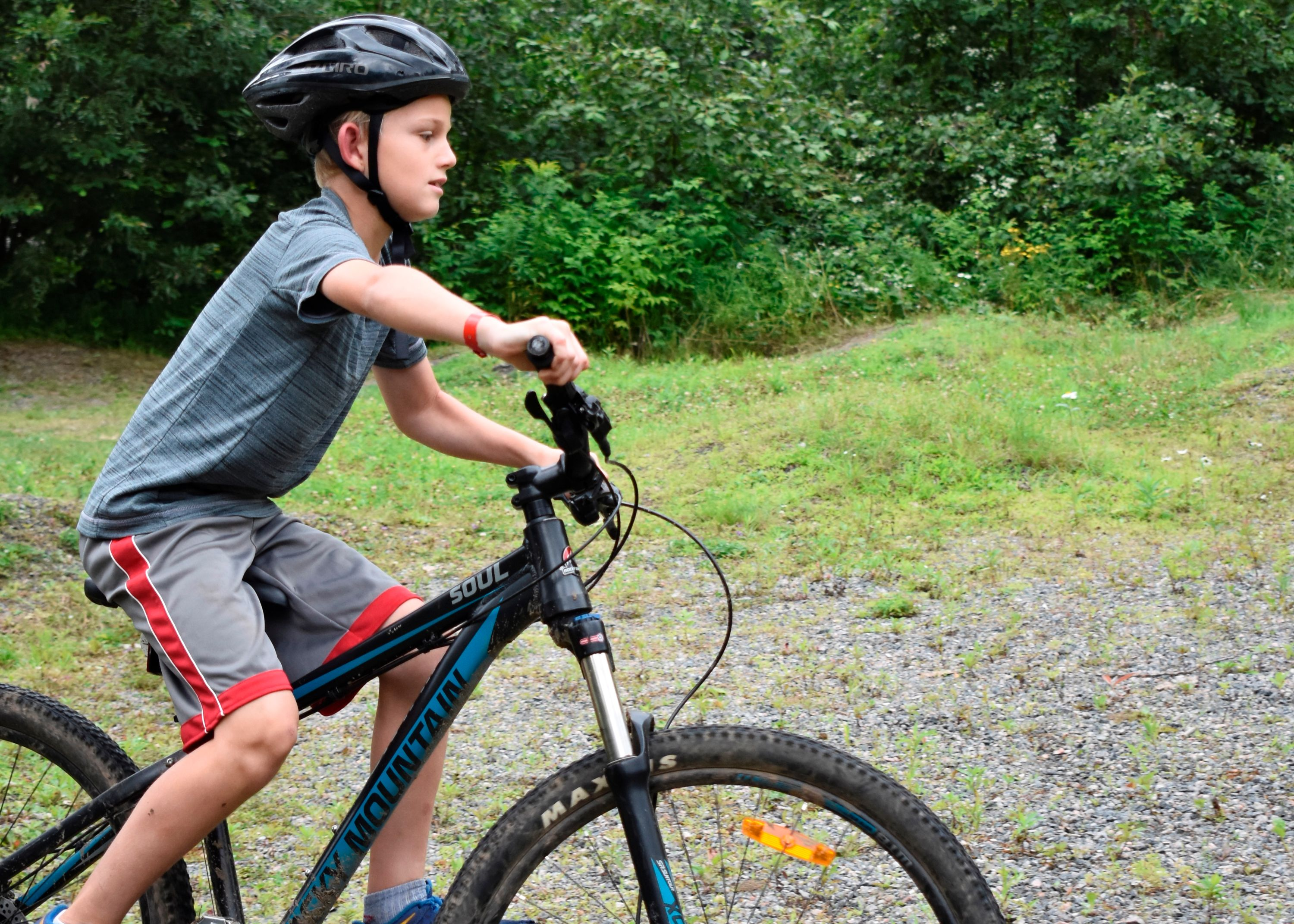 camper mountain biking at christian adventure Summer Camp in Haliburton, Ontario
