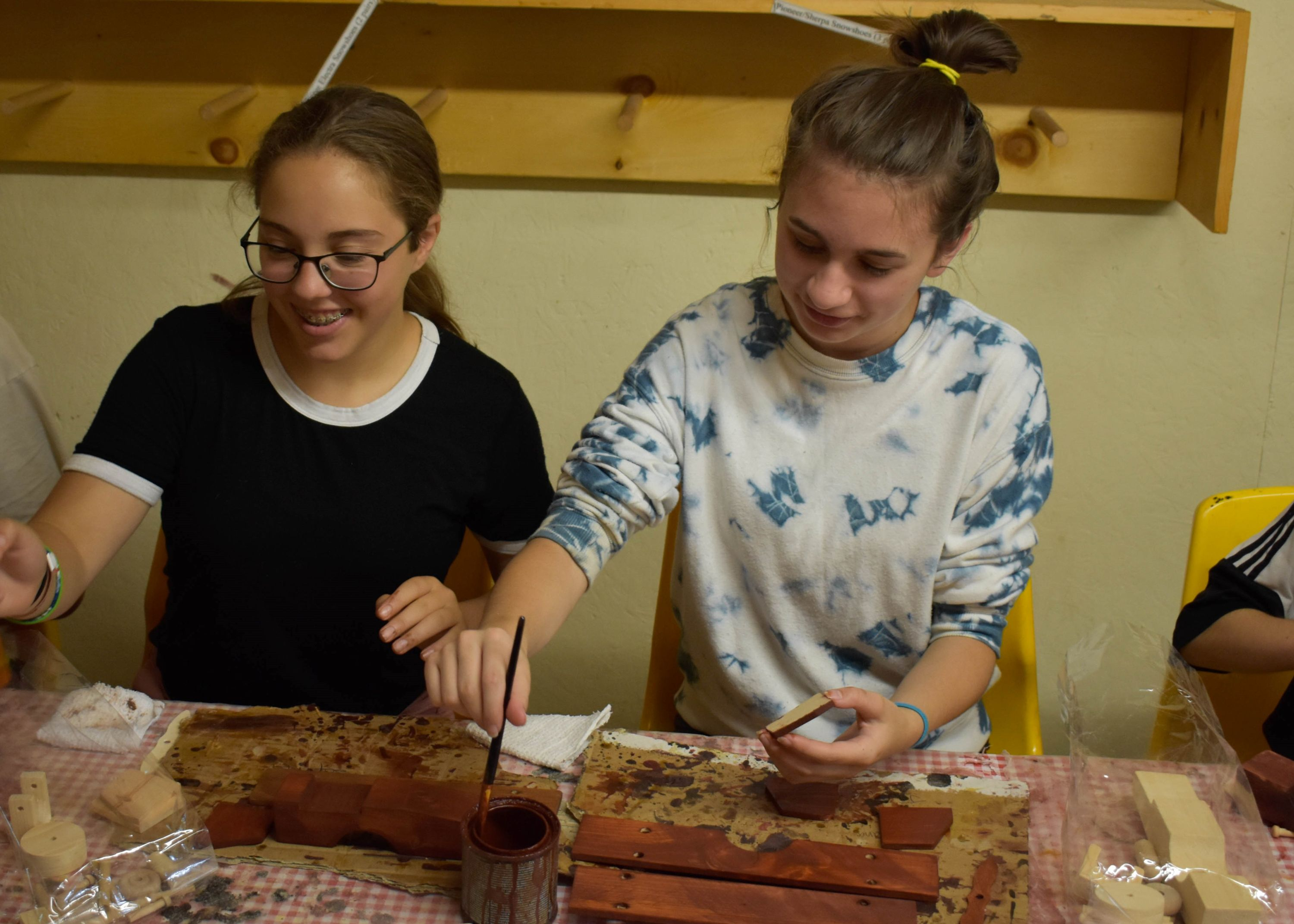 campers working on their woodworking project at christian adventure summer camp in haliburton, ontario