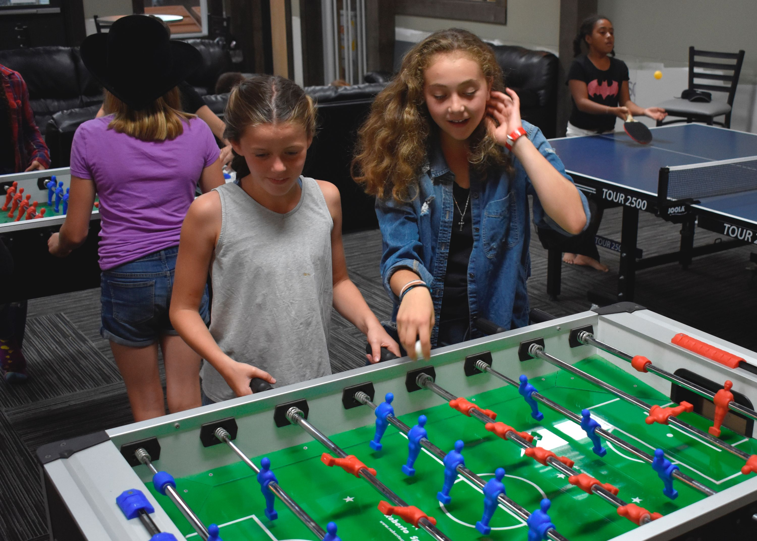 Campers playing games in canyon lounge at christian adventure summer camp in haliburton, ontario