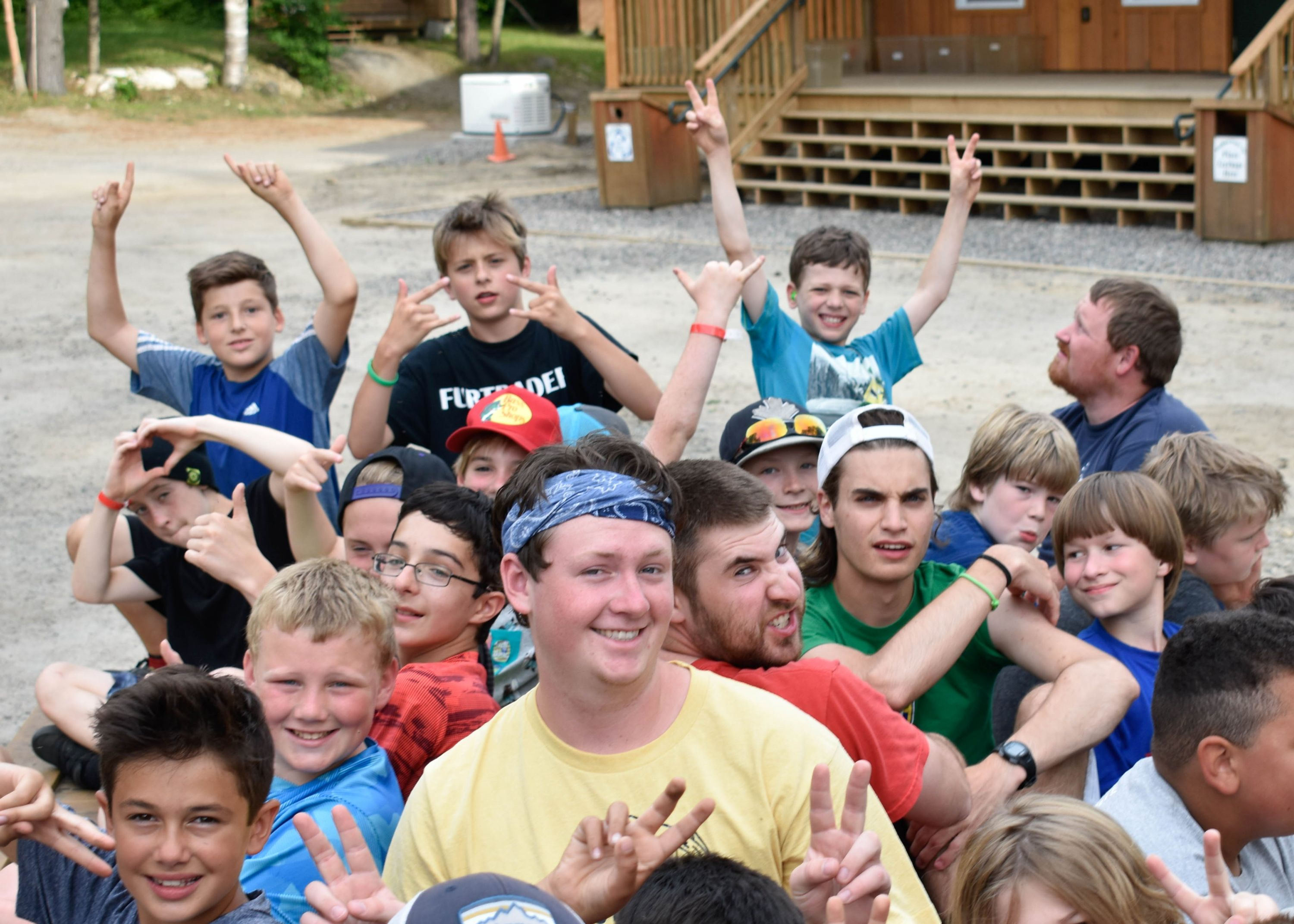 Guy campers having fun at christiana adventure summer camp in haliburton, ontario