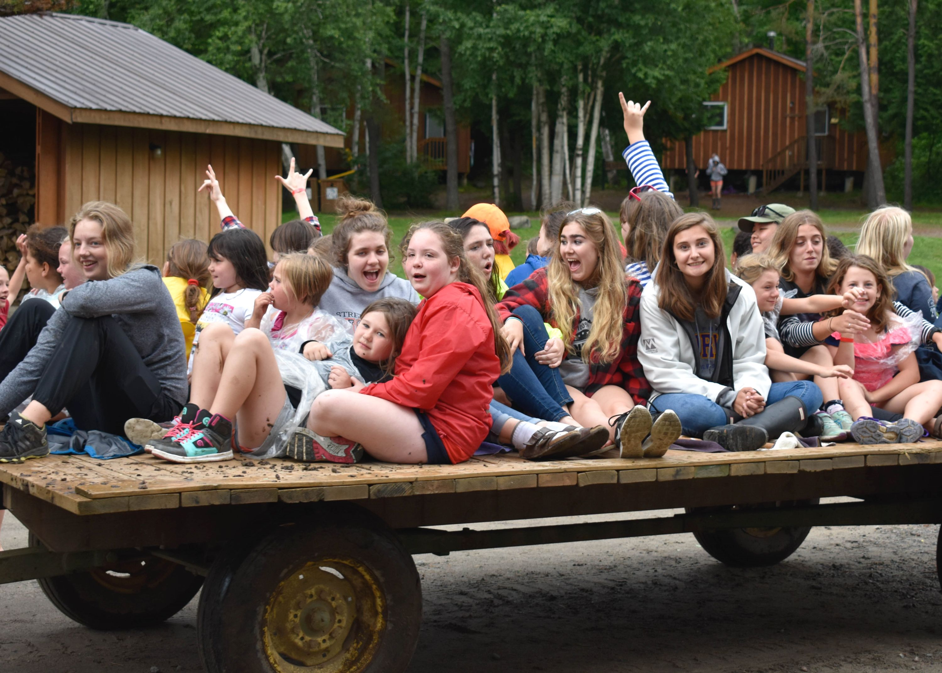 Campers on wagon at christian adventure summer camp in haliburton, ontario
