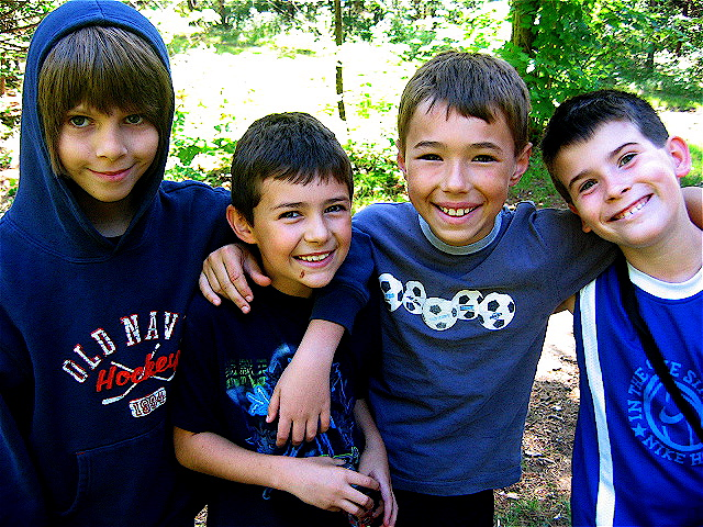 Boy campers in a group and smiling