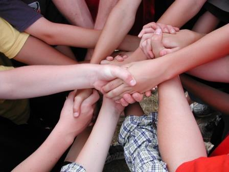 Group of students holding hands in Haliburton Ontario
