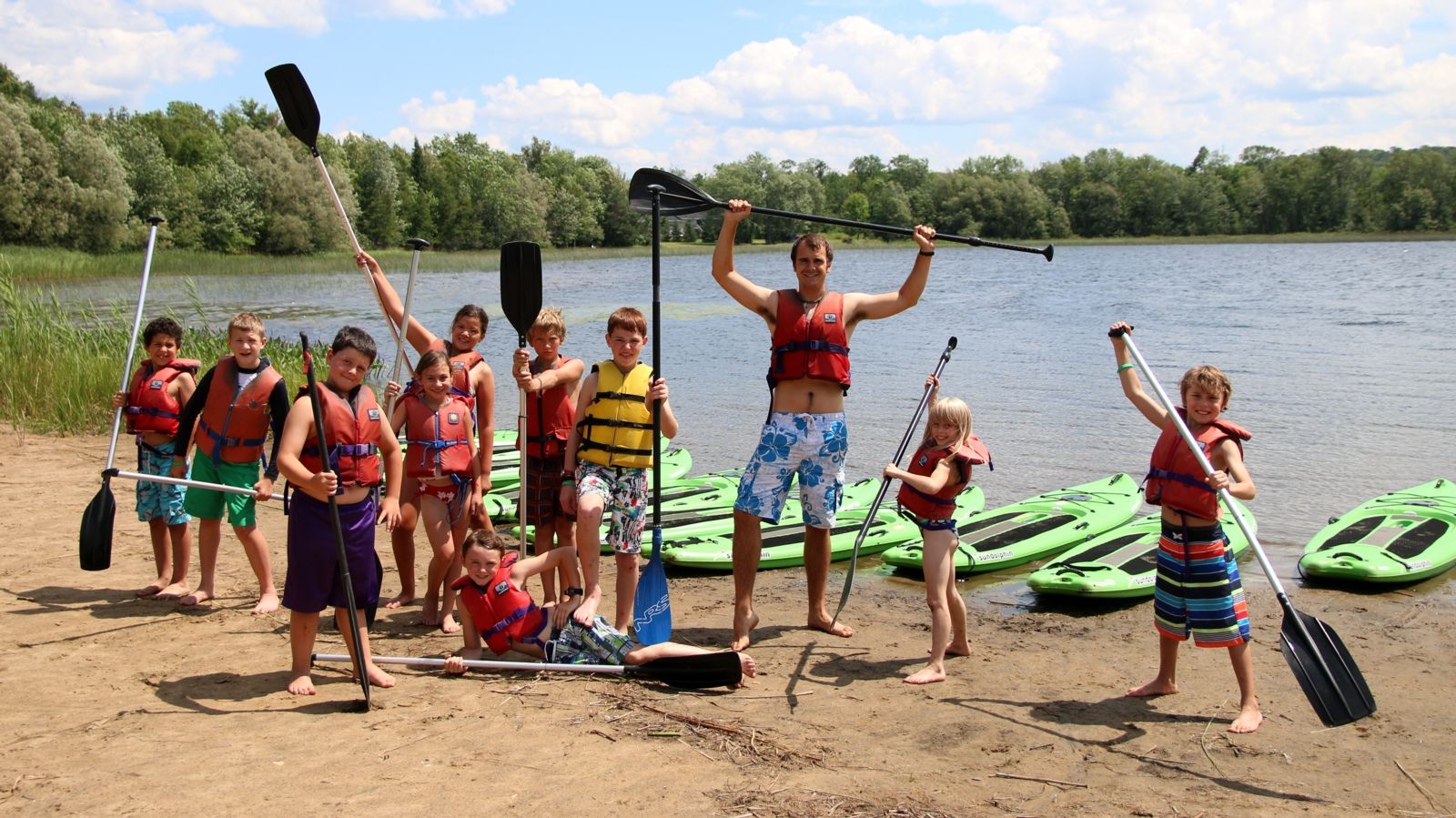 Camper group going SUP in Haliburton, Ontario
