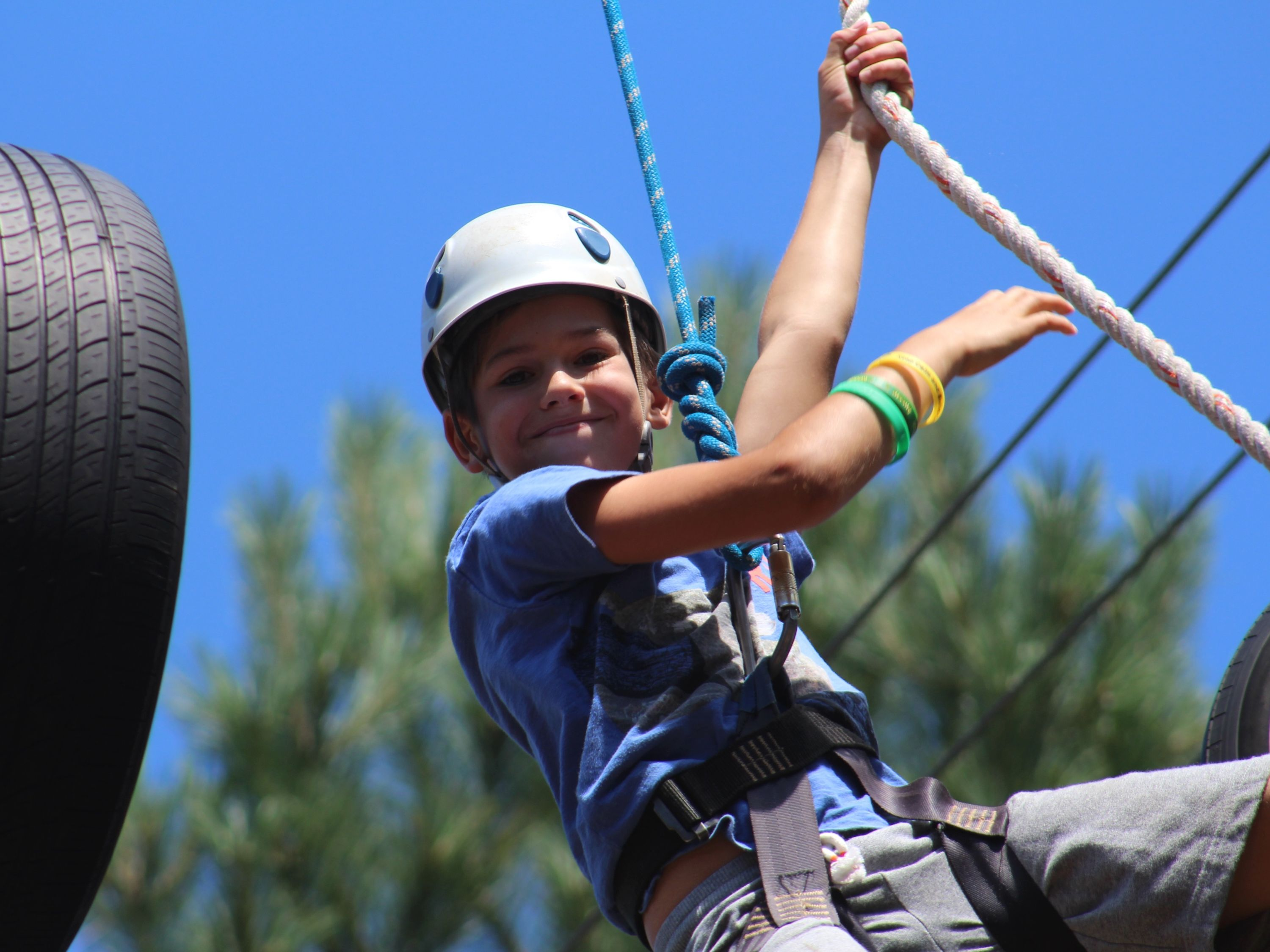 Discovery boy on ropes course, summer camp, ontario