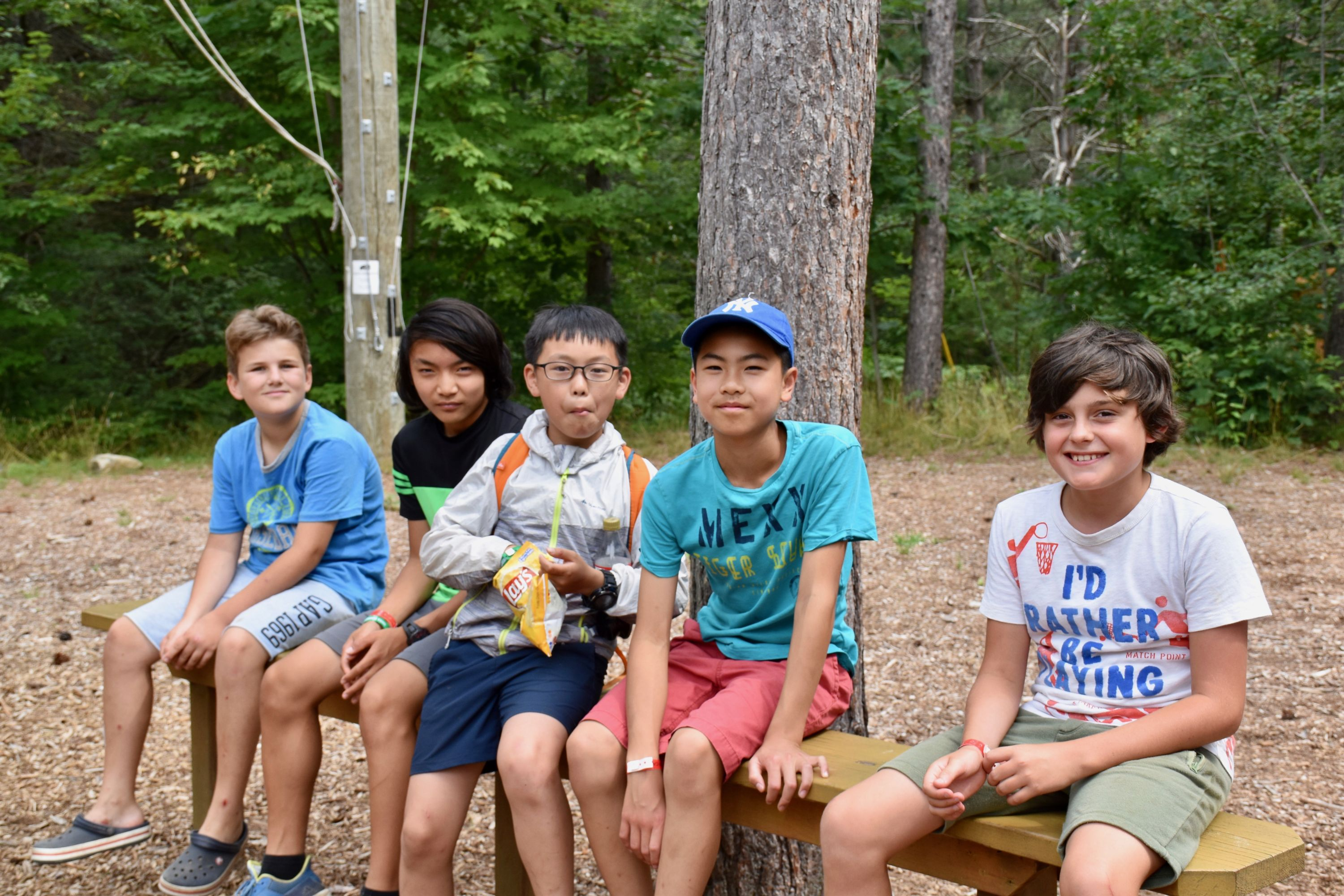 Campers sitting at high ropes at Medeba Summer camp, ontario