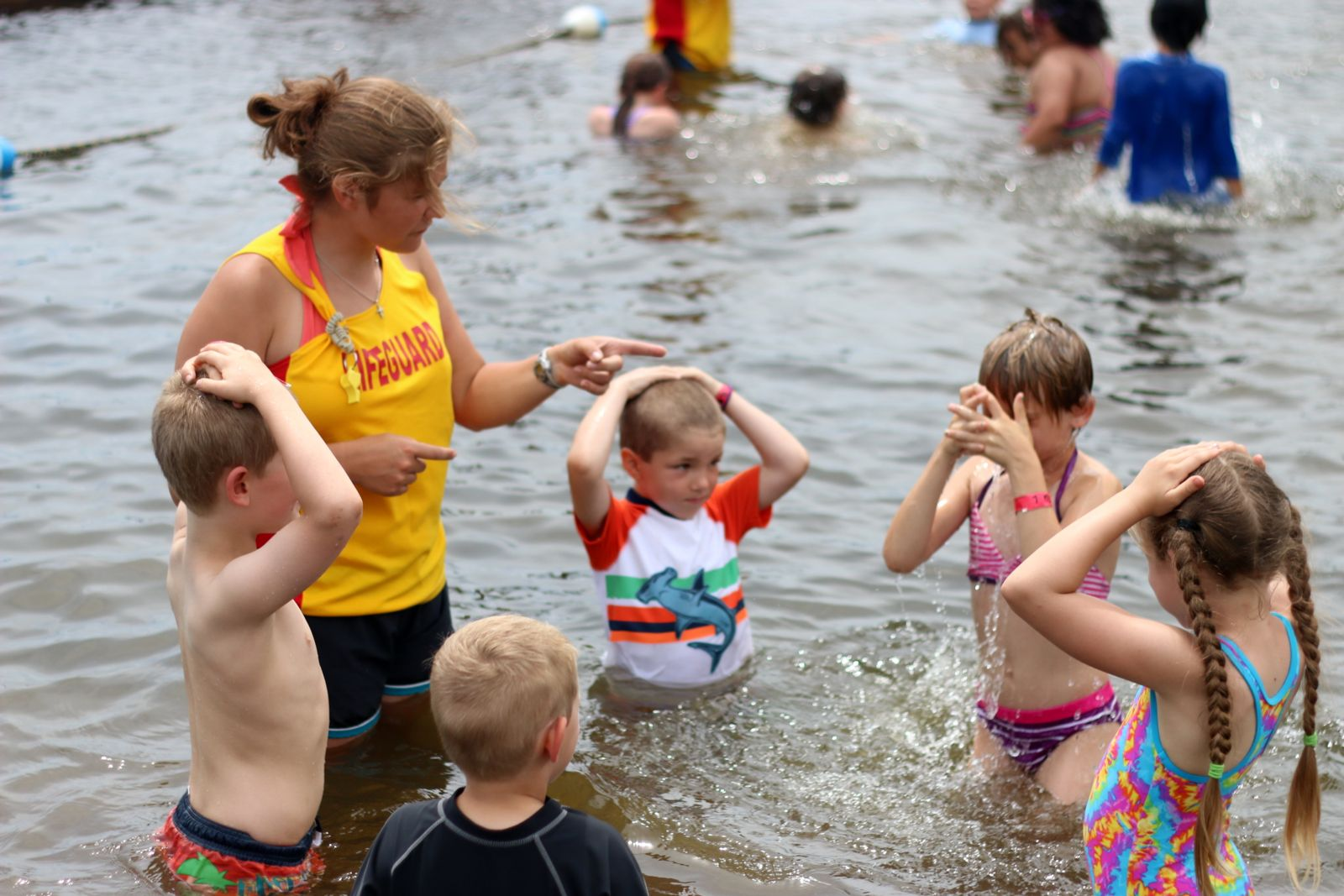Children partaking in swimming lessons at the waterfront